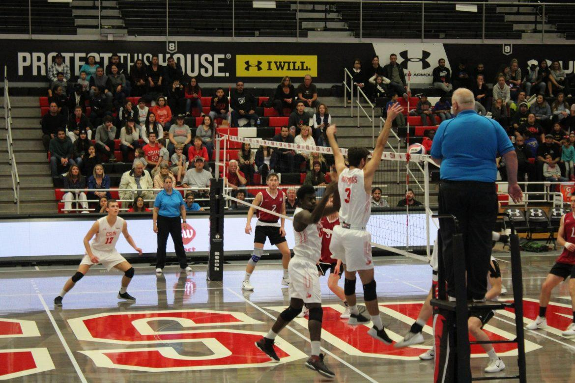 CSUN mens volleyball dressed in white uniform play defensively