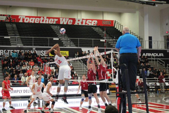 CSUN mens volleyball goes to spike the ball on the opposing team