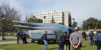 space ship on the oviatt lawn with many people surrounding it