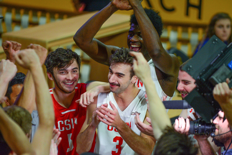 CSUN mens volley ball team happily celebrate