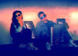 retro photo of two people siting in the floor with keyboards