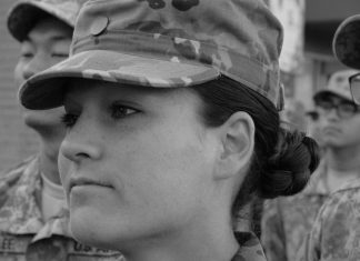 woman dressed in army uniform looking serious