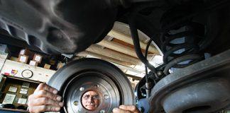 A man looks through a rotor disc