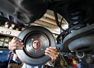 A man looks through a rotor disc