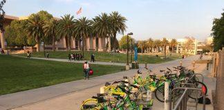green and yellow lime bikes in bike rack