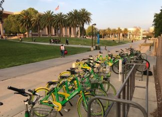 green and yellow lime bikes in bike rack