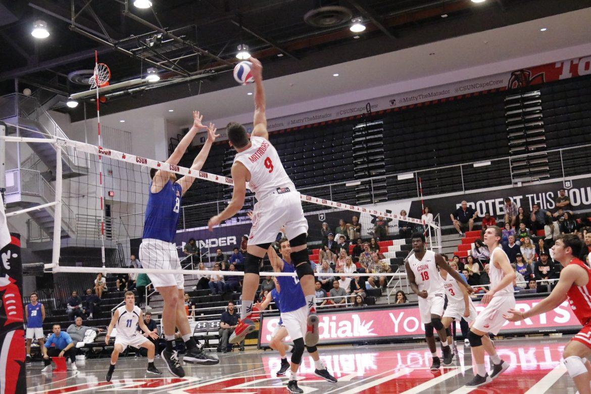 csun+mens+volleyball+player+in+white+goes+to+spike+the+ball