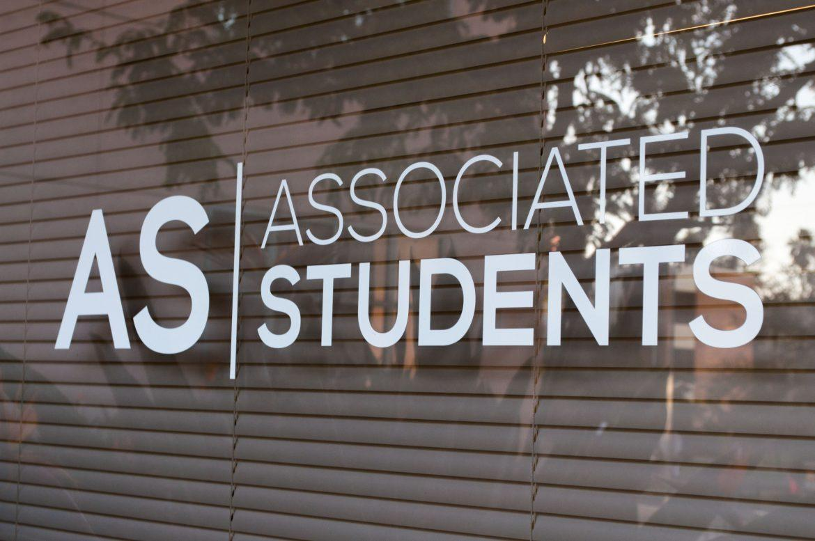 white Associated Students logo on a window