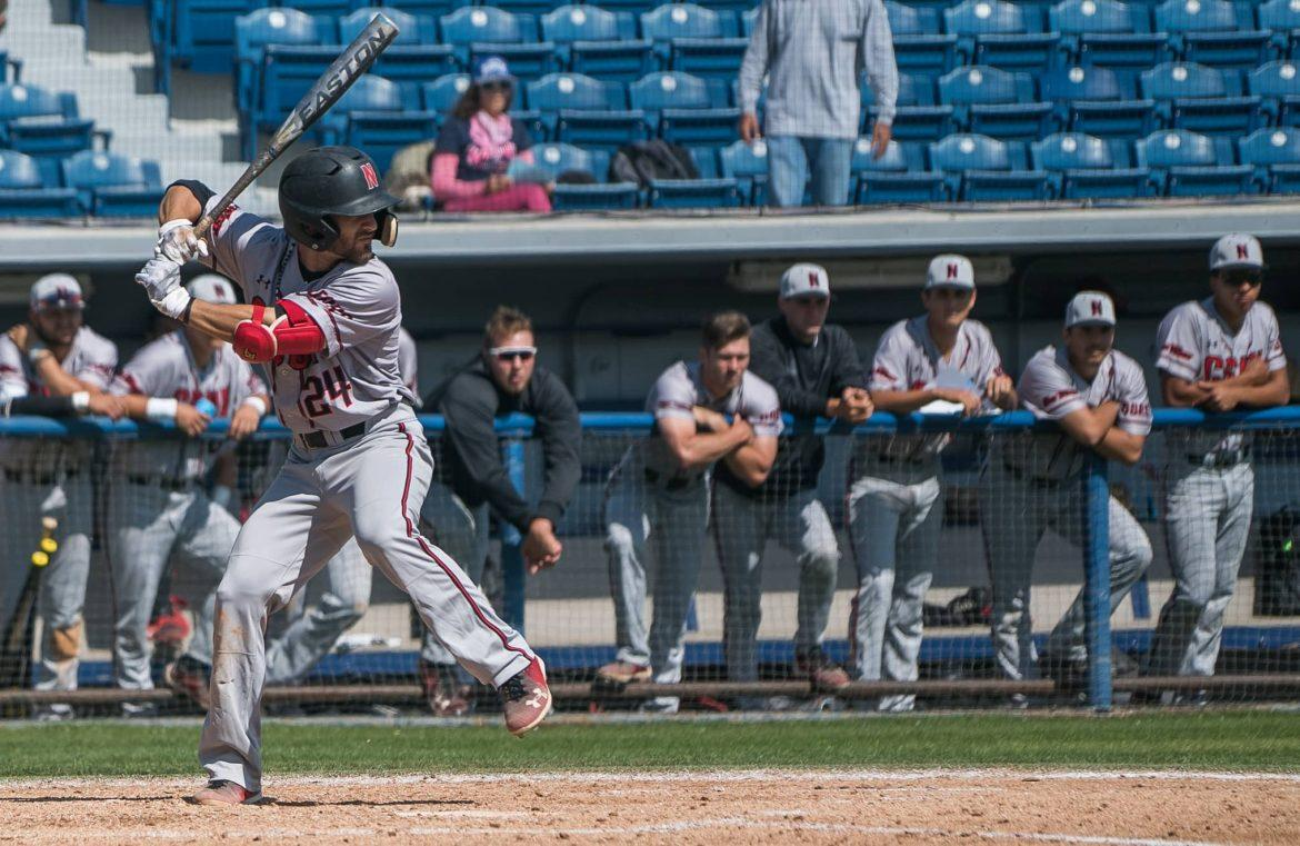 CSUN baseball player in grey uniform at bat