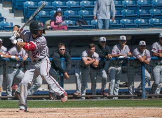 CSUN baseball player in grey uniform at bat