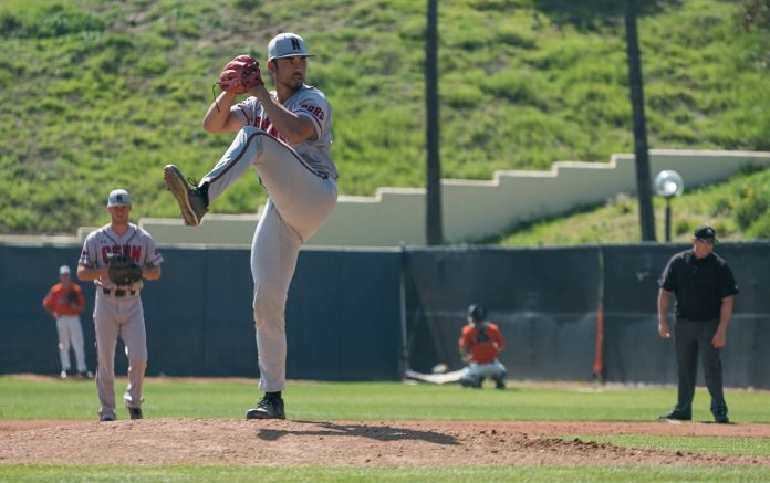 CSUN baseball pitcher at mound getting ready to throw the ball