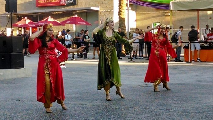 woman dressed in red and green traditional Persian dance wear