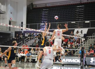 CSUN mens volleyball player goes to spike the ball