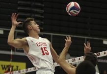 CSUN mens volleyball dressed in white goes to spike the ball