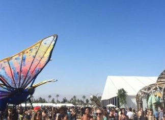 large butterfly statue over a crowd