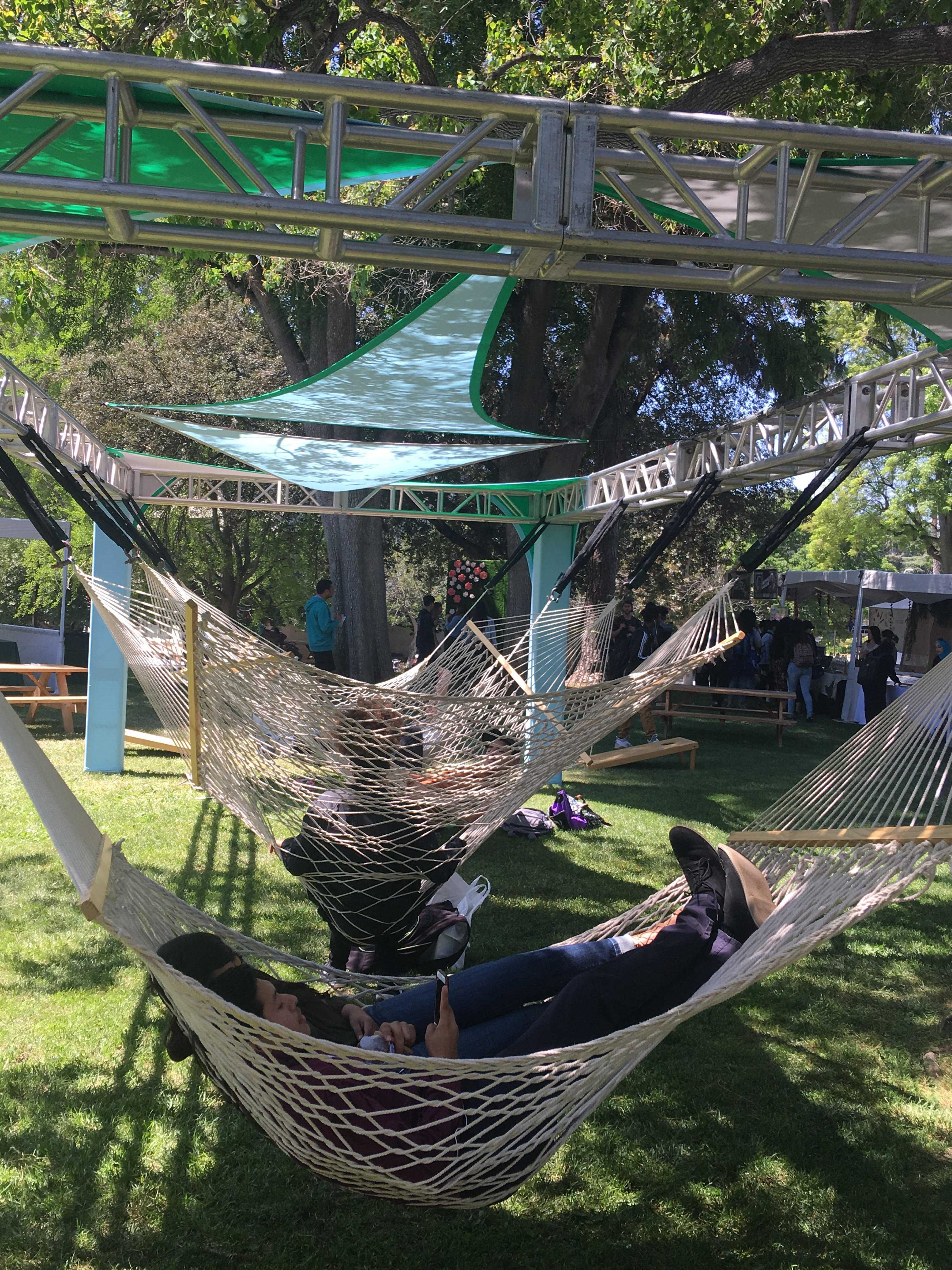 students lay in hammocks