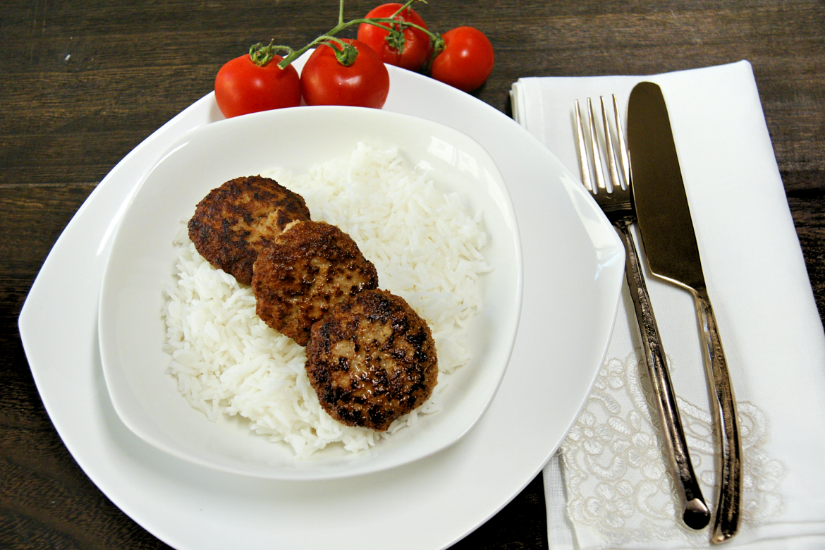 cooked meatballs on top of white rice