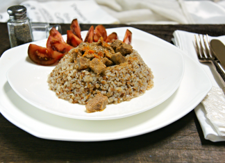 white plate with tomatoes and beef based meal