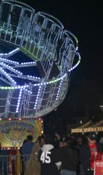 people excitedly spin on a carnival ride