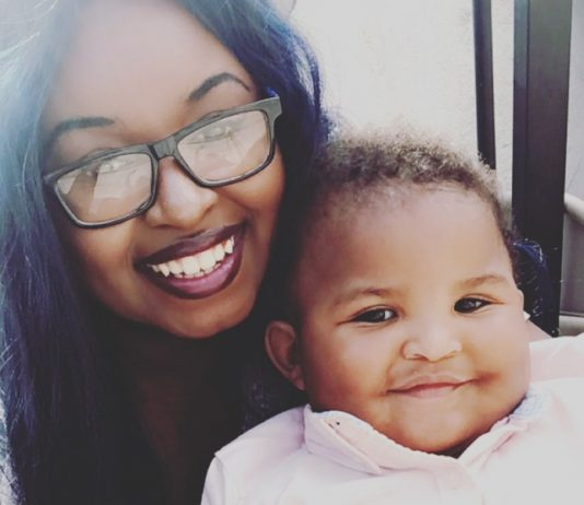 woman and baby happily pose for selfie