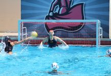 women play water polo