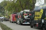 different types of food trucks parked on the road