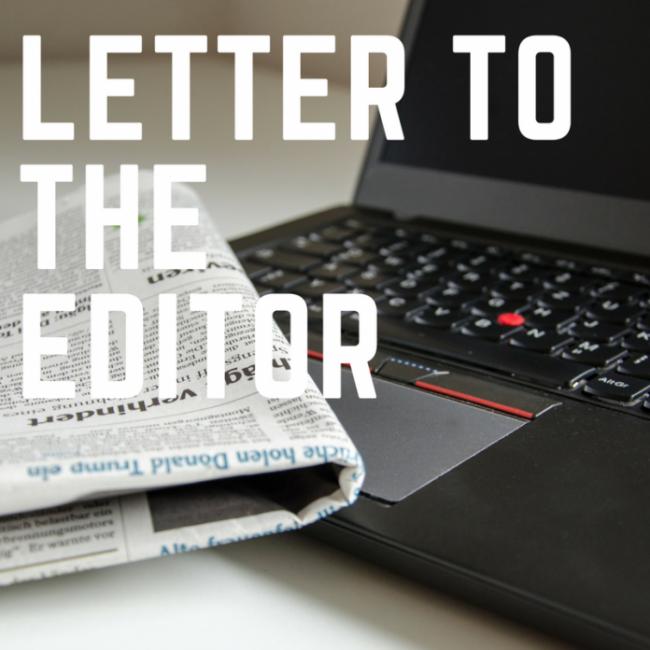 newspaper on a black laptop