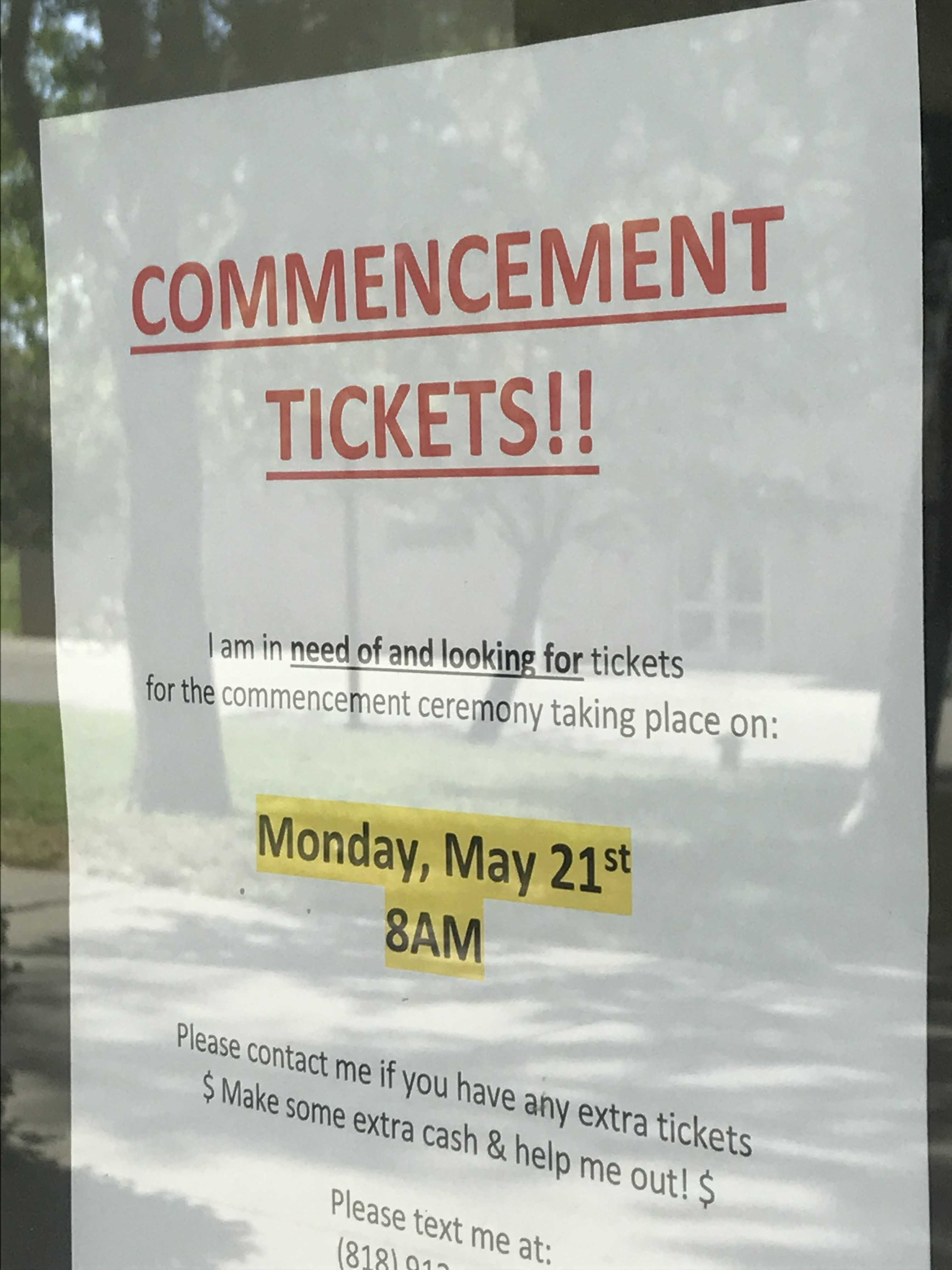Posters like this one (outside Sierra Hall) litter the campus, as students desperately seek last minute graduation tickets. Photo credit: Tandy Lau
