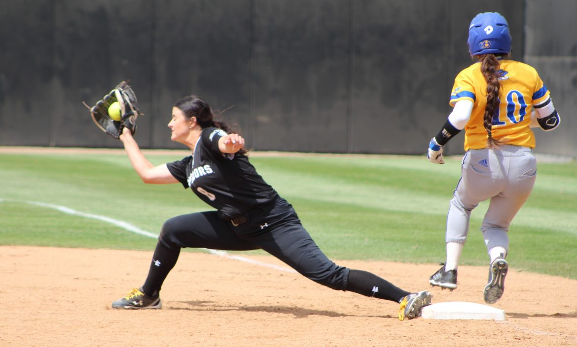 CSUN+womens+softball+player+stretches+from+base+to+catch+the+ball