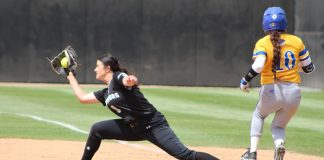 CSUN womens softball player stretches from base to catch the ball