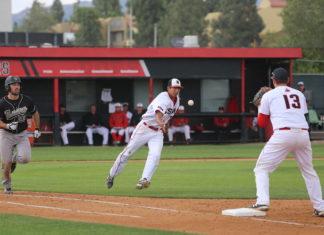 3 guys playing baseball