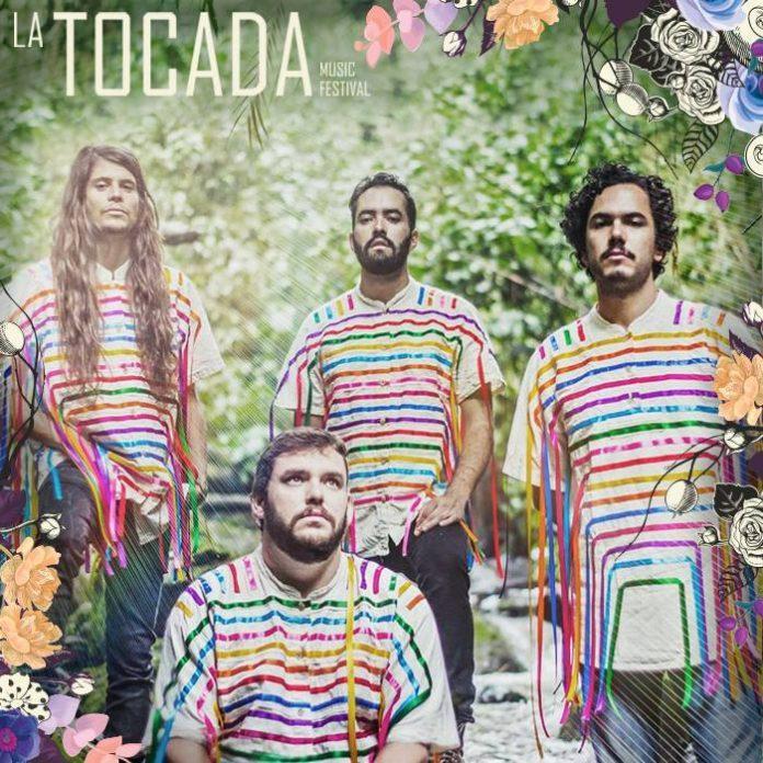 4 guys wearing rainbow striped shirts