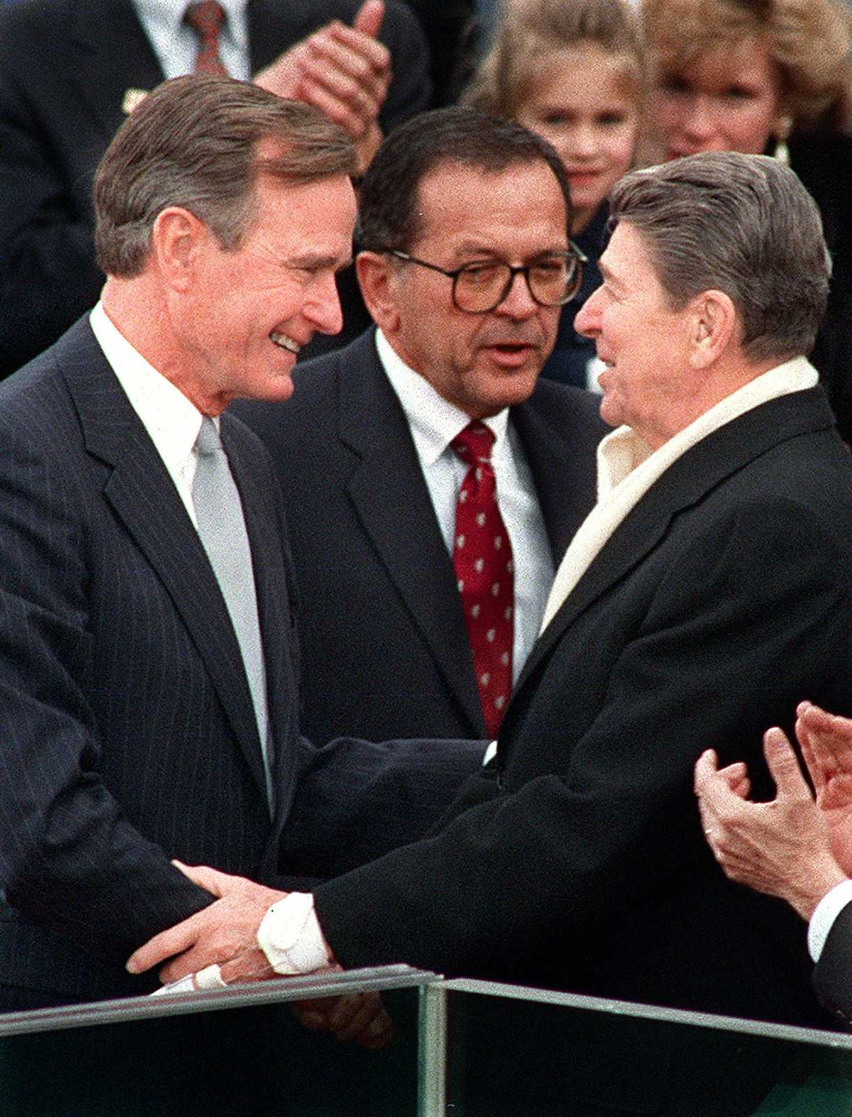 President Ronald Reagan greets newly-inaugurated president George Bush, Sr., during Bush's swearing-in ceremony, January 20, 1989, in Washington, D.C. (Mimi Out) (June 8) Photograph by Joe Burbank/ Orlando Sentinel