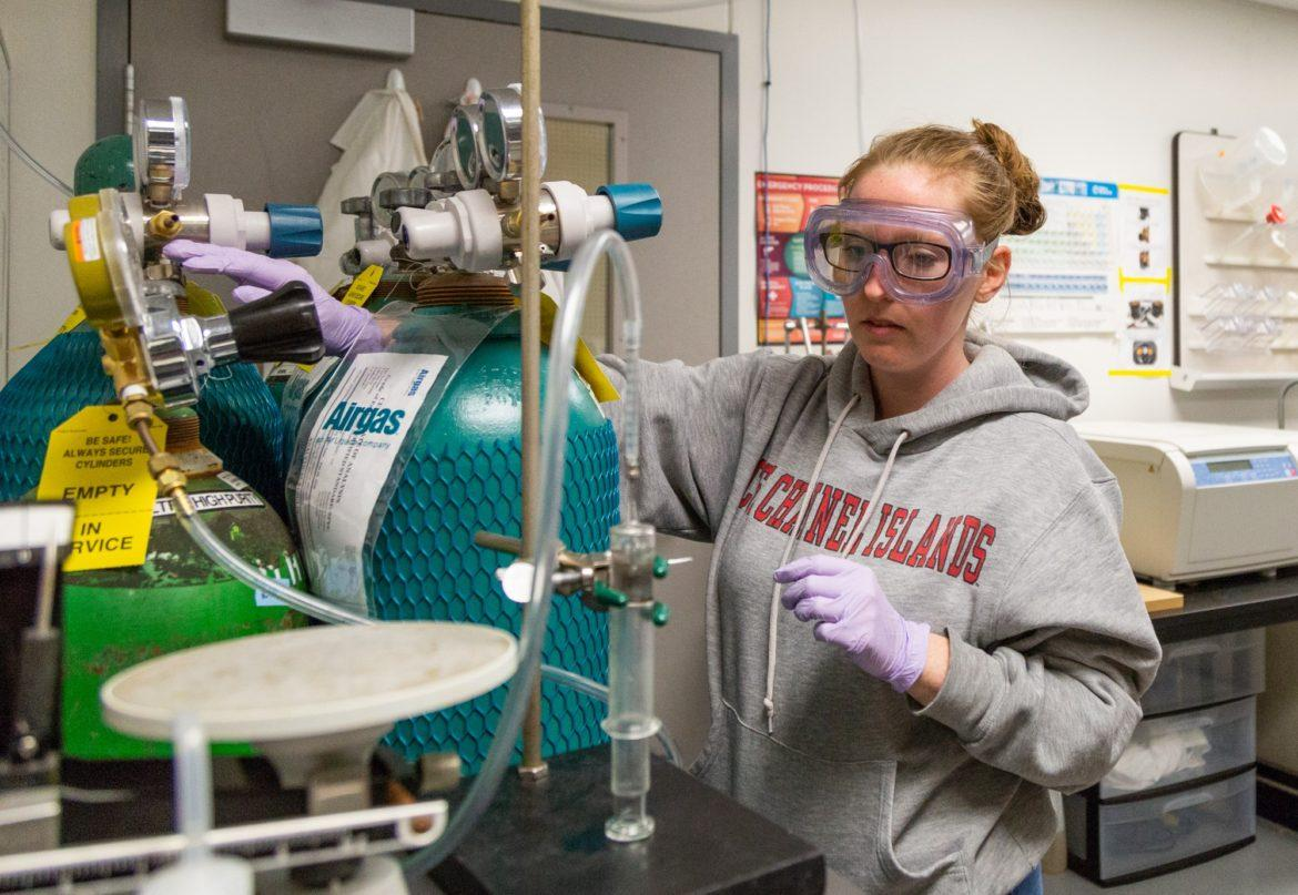 student using chemistry equipment