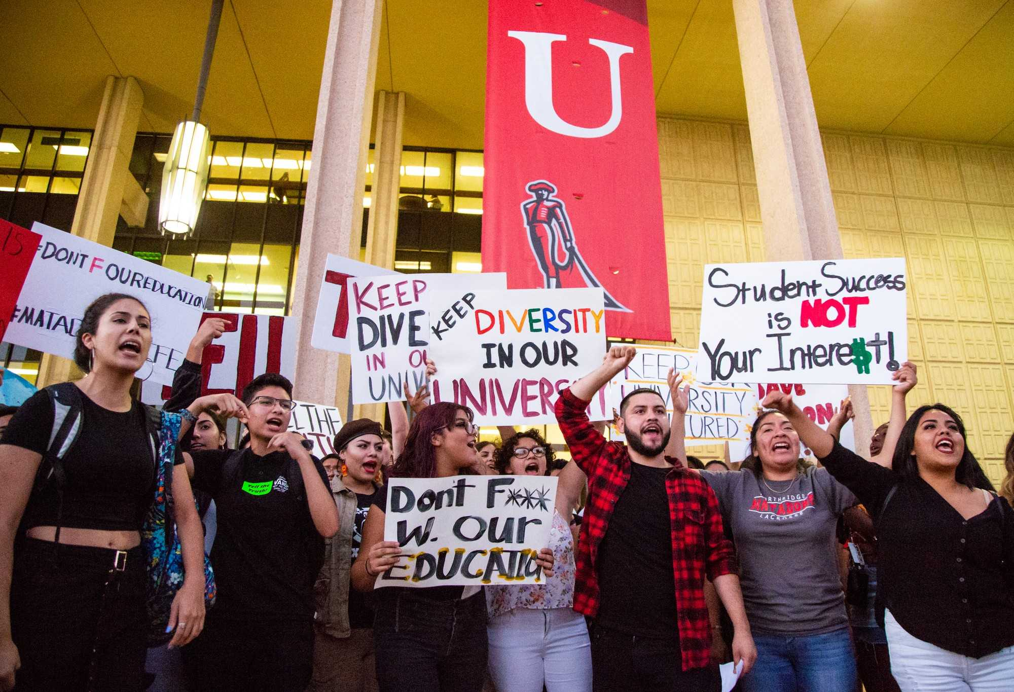 Students protest against the implementation of Executive Order 1100 at the Student Convocation 2018 on Thursday. Photo credit: Roberto Cisneros