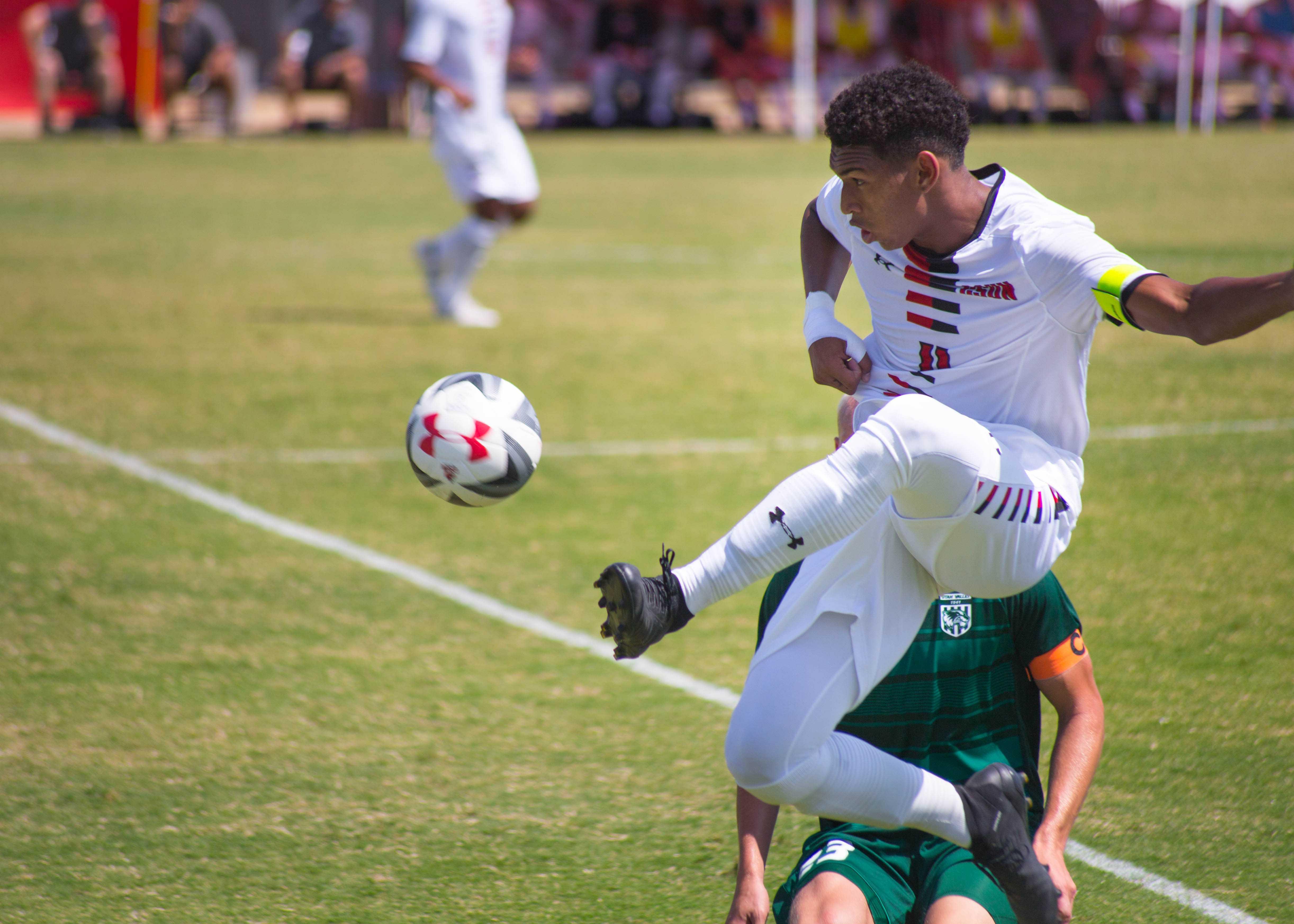 Defender Ehi Isidor jumps for the ball over a Utah Valley defender. Photo credit: John Hernandez