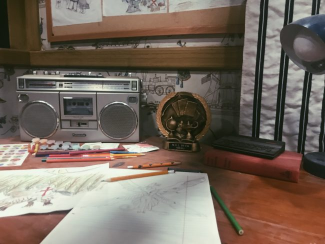 desk with radio and trophy