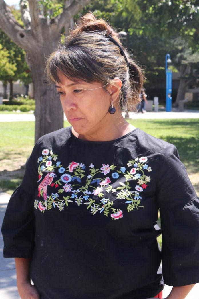 woman with black shirt looking down
