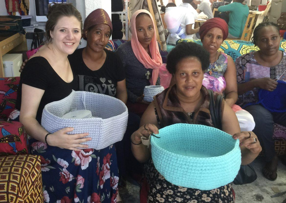 women+holding+colorful+baskets