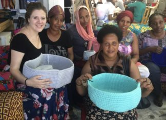 women holding colorful baskets