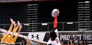 volleyball player hitting ball