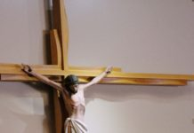 chruch member touches feet of the cross