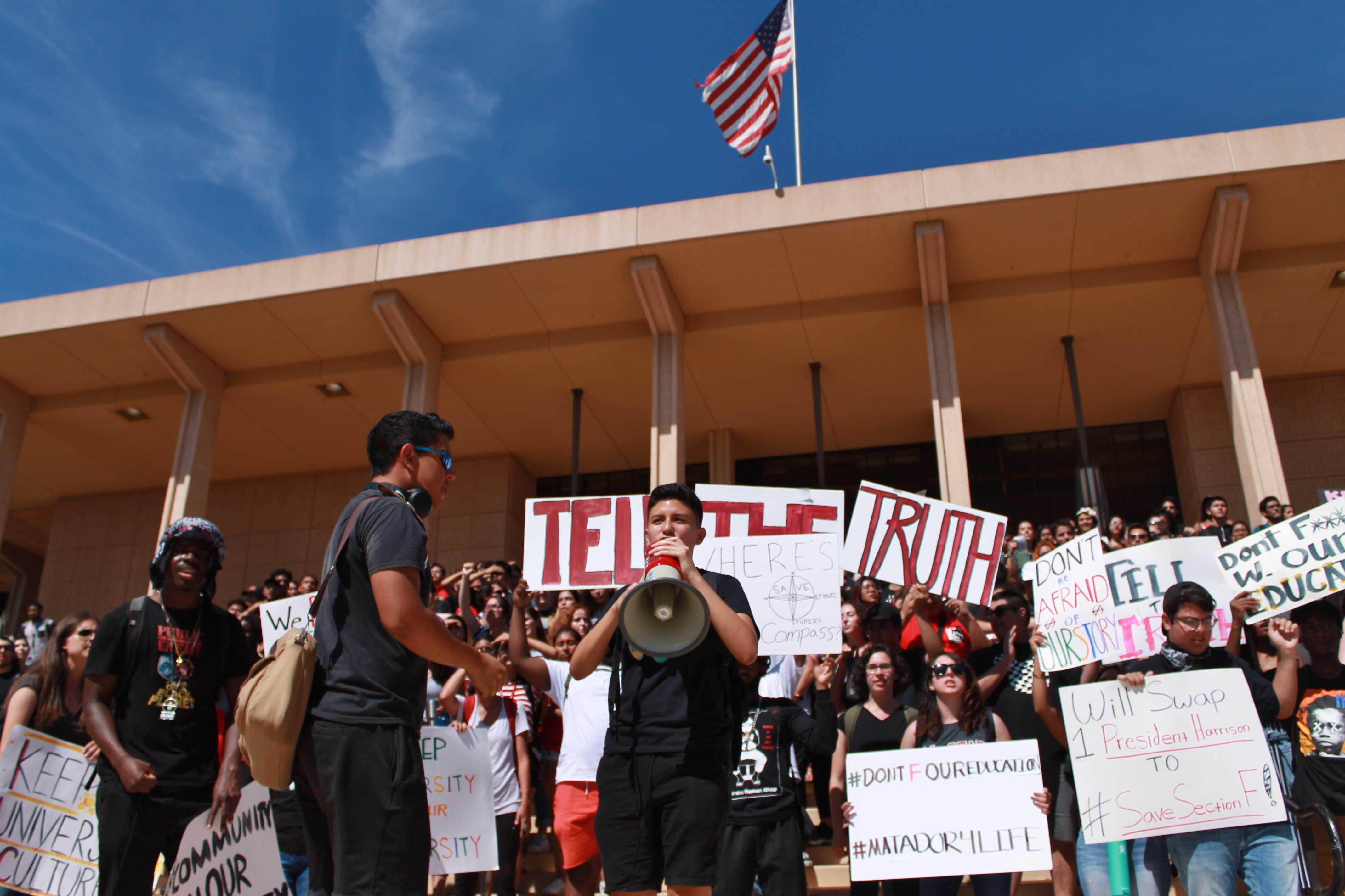 Students and faculty gather together on the steps of the Oviatt Library to protest Executive Order 1100-R and demand resignation of CSUN's President and Faculty Senate President on Thursday, Sept. 27. Photo credit: Clare Calzada