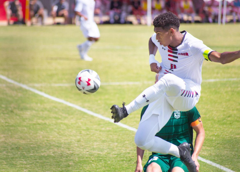 soccer player hitting ball