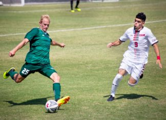 2 guys playing soccer