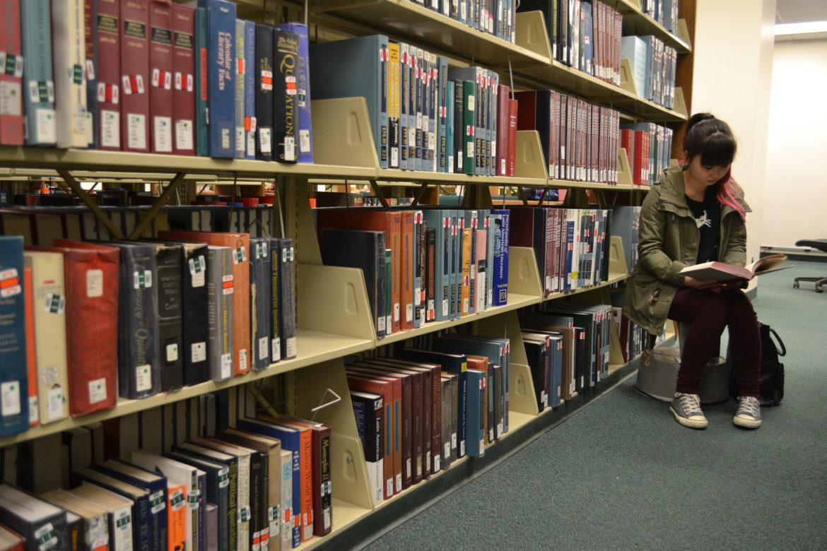 student+reading+in+library