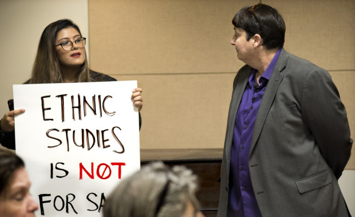 student protesting in meeting