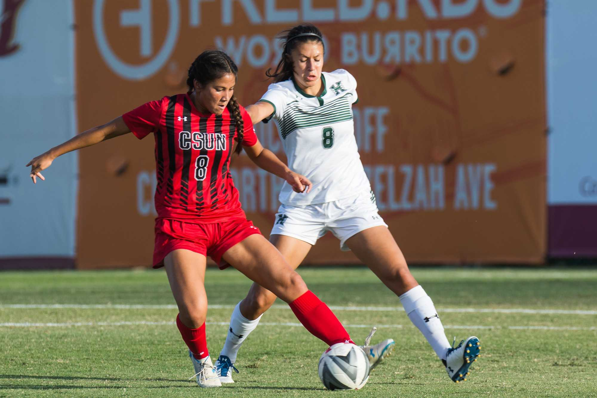 Sophomore Amy Aquino puts a move on Hawaii Defender Elena Palacios. Photo credit: Joshua Pacheco