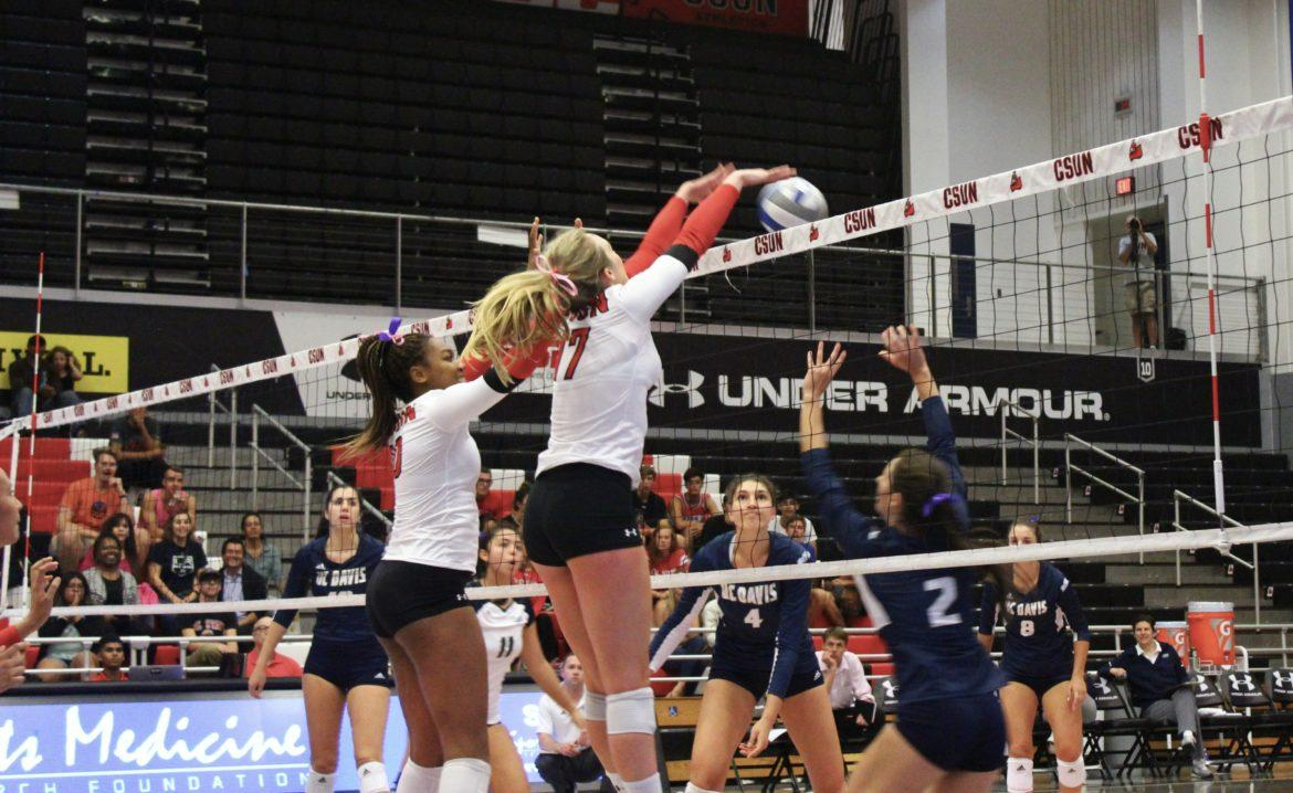 Lexi+McLeod+and+Morgan+Salone+ready+to+block+against+UC+Davis.