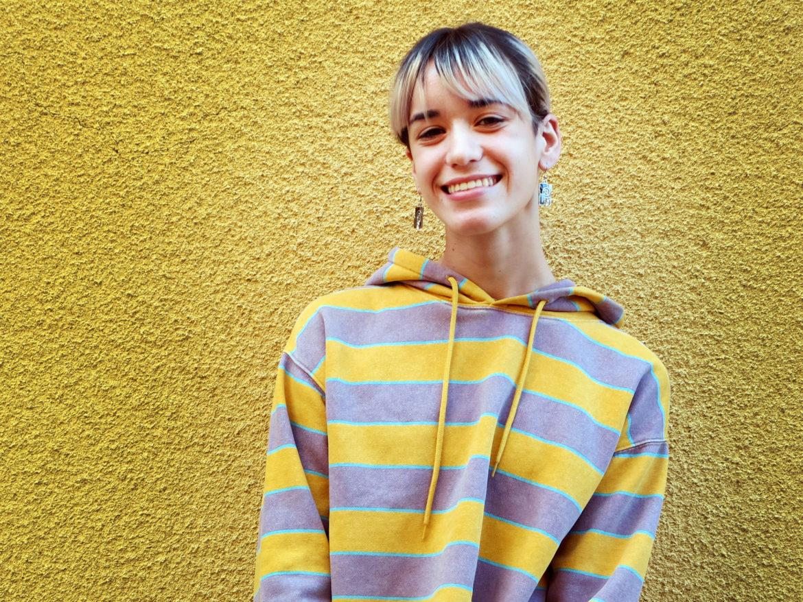 student with striped yellow sweater